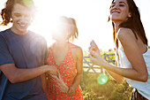 Friends spending lighthearted day together outdoors