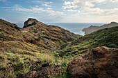 coastal road leading to the beach between Hermigua and Agulo, view towards Teide volcano, La Gomera, Canary Islands, Spain