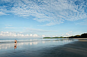 People walking along Long Beach Ao Yai, Ko Phayam, Andaman coast, Thailand, Southeast Asia