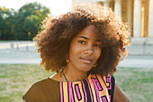 Young afro-american woman in backlight scenery on Koenigsplatz, Munich, Bavaria, Germany