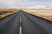The ring road leads through a rugged winter landscape, between Reykjavik und Blönduós, Iceland.