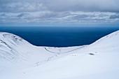 View of the valley named Mánárdalur towards the open Greenland Sea near Siglufjörður, Tröllaskagi or in English Troll Peninsula, Iceland