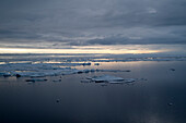 Evening dawn in the drift ice of the Arctic ice pack north of Spitsbergen, Svalbard, Norway