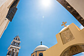 The Catholic church with bell tower in the capital of the island, Fira, Santorin, Cyclades, Greece
