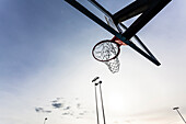A sports field for the national sport basketball with the basket from the worm's-eye view outside, Ft. Myers Beach, Florida, USA