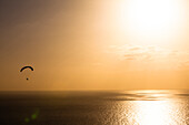 Paragliding over the Atlantic on the west side of the island during sunset, Puerto de Naos, La Palma, Canary islands, Spain