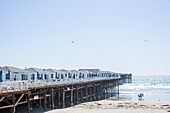 An image of San Diego's Crystal Pier, a popular vacation destination since the 1930s, taken from the beach.