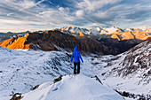 Hiker enjoying the panoramic view in the South Tyrolean Alps, Pfunderer Berge, Italy