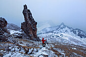 Hiker watching a sudden change of weather, Cadini Group, Sexten Dolomites, Unesco world heritage, Italy