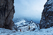 Hiker watches sudden change of weather, Cadini Group, Sexten Dolomites, Unesco world heritage, Italy