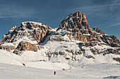 Snowshoe hiker beneath the Dreischusterspitze, Sexten  Dolomites, Unesco world heritage, Italy