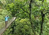 Women on Costa Rican canopy walk looks for wildlife
