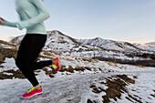 Female running on the Bonneville Shoreline Trail behind the University of Utah in Salt Lake City, Utah