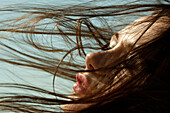 Caucasian woman with hair blowing in wind