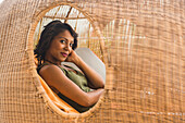 African American woman lounging in cabana