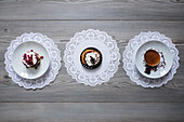 Plates of dessert on lace doilies