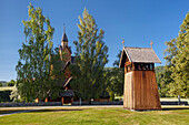Heddal Stave Church with its freestanding, wooden bell tower in summer, Notodden, Telemark, Norway, Scandinavia