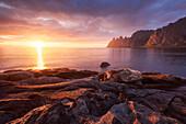 Impressive sunset above the Okshornan cliffs on Ersfjordr in northern Norway, Island of Senja, Troms Fylke, Norway, Scandinavia