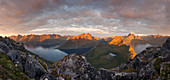 Panorama from the summit of Segla to the island of Senja with over 1000m high mountains on Øyfjorden (left) and Mefjorden (right) in the last evening light, Fylke Troms, Norway, Scandinavia