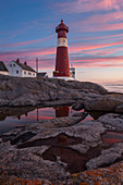 Picturesque sunset above the lighthouse Tranøy Fyr in summer with it's reflection, Tranøya, Hamarøy, Nordland, Norway, Scandinavia