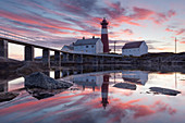 Picturesque sunset above the lighthouse Tranøy Fyr in summer with it's reflection in the ocean, Tranøya, Hamarøy, Nordland, Norway, Scandinavia