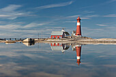 The red lighthouse Tranøy Fyr on a sunny summer day with it's reflection in the sea, Tranøya, Hamarøy, Nordland, Norway, Scandinavia