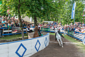 Castelrotto, South Tyrol, Italy. The traditional ring jousting at the Monte Calvario in Castelrotto