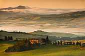 Italy, Tuscany, Siena District, Orcia Valley - Farmhouse at sunrise