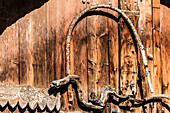 A wooden hut in the Alps, decorated with carvings and wooden stick look like a snake, Santa Maria im Münsterland, the Grisons, Switzerland