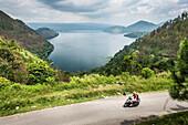 Tourist exploring Lake Toba (Danau Toba) by motorcycle, North Sumatra, Indonesia, Southeast Asia, Asia