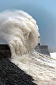 Huge waves crash against the harbour wall at Porthcawl, Bridgend, Wales, United Kingdom, Europe