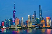 China, Shanghai City, Pudong District Skyline, Oriental Pearl and Shanghai Towers, Huanpu River.