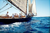 Vintage boat sailing in a race, at the Mediterranean Sea. Menorca. Baleares, Spain, Europe