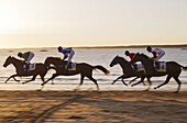 Shortly before sunset at the famous horse races of Sanlúcar de Barrameda which take place every year during August along a 1.800m stretch of beach at the mouth of the River Guadalquivir. This tradition dates back to 1845. On the opposite river bank the fa