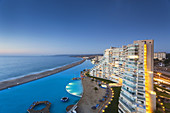 Chile, Algarrobo, San Alfonso del Mar, World´s largest man-made pool, elevated view, dusk.