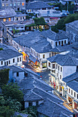 Albania, Gjirokastra, elevated town view from the castle, dusk.