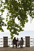 Greece, Thessaly Region, Makrinitsa, Pelion Peninsula, outdoor cafe tables with people.
