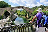 Roman bridge over river Sella, XIVth century, Although known as the Roman bridge, its construction was during the reign of Alfonso XI with its famous stilted arch and two smaller arches are unequal, this bridge may well be a reconstruction of a previous o