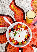 Healthy breakfast of muesli, fruits, yogurt at Villa Blanche Bistro, Goa, India.