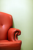 Half image of a leather arm chair, Moscow, Russia, Europe.