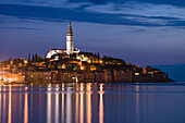 Croatia, Istria Peninsula, Rovinj, Illuminated waterfront buildings and bell tower