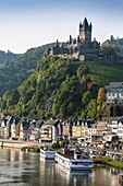 The beautiful Reichsburg Cochem (Cochem Imperial Castle) with village and the river Moselle in the foreground, Cochem, Rhineland-Palatinate, Germany, Europe