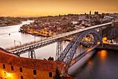General view of Douro river and city of Oporto al sunset. Porto (Oporto), Portugal.
