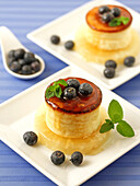 Cheese tart with honey and blueberries.