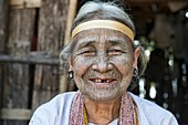 A 90 year old Yindu Chin woman with face tattoos in Kanpetlet, Myanmar. The tribal Chin women had their faces tattooed when they were around 15 years old, purportedly to protect them from being carried away by marauding men. The practice is now banned, an
