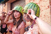 150 tons of tomatoes serve as ammunition for traditional Tomatina, a battle which attracted this year more than 22,000 people of 96 different nationalities to launch a record number tomatoes. Buñol, Valencia province, Spain.