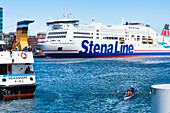 Rower, the ferry to Sweden and the passenger ferry on the Kieler Förde in the harbour, Kiel, Schleswig Holstein, Germany