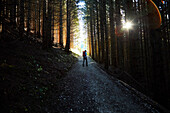 Woman hiking in a dark forest