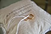 Wedding rings on pillow in  Vale do Lobo, Algarve, Portugal