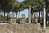 Rome. Italy. Ostia Antica. Marble theatrical masks at the rear of the theatre.